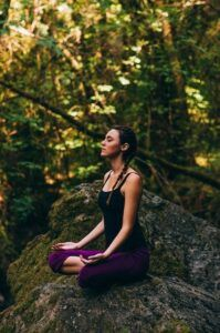 Yoga lady in forest