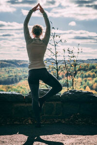 Tree pose near forest