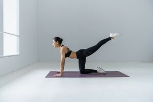 Lady doing yoga on the mat